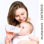 Feeding Baby. Baby Eating Milk...