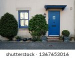 front door and porch of an... | Shutterstock . vector #1367653016