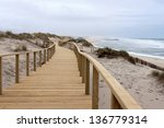 Long Wooden Boardwalk Along Th...
