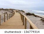 Long Wooden Boardwalk Along Th...