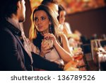 young woman with a glass of... | Shutterstock . vector #136789526