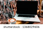 a cup of coffee with laptop on... | Shutterstock . vector #1368029606