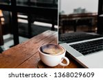 a cup of coffee with laptop on... | Shutterstock . vector #1368029609