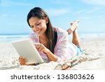 Carefree Woman Uses Touchpad...