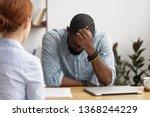 stressed upset african... | Shutterstock . vector #1368244229