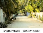 maldivian street with palms and ... | Shutterstock . vector #1368246830