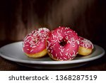 donuts with pink icing on... | Shutterstock . vector #1368287519