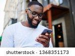 positive millennial man... | Shutterstock . vector #1368351173