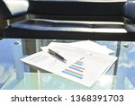 financial chart and pen on... | Shutterstock . vector #1368391703