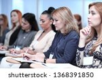 listeners take notes in... | Shutterstock . vector #1368391850