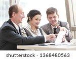 business team using tablet... | Shutterstock . vector #1368480563