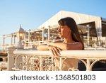 cute woman enjoys sunset light  ... | Shutterstock . vector #1368501803