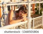 cute woman enjoys sunset light  ... | Shutterstock . vector #1368501806