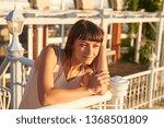 cute woman enjoys sunset light  ... | Shutterstock . vector #1368501809