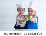 cheerful  little boy and girl... | Shutterstock . vector #1368536606