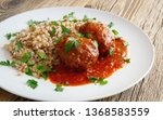 meat cutlets in tomato sauce...   Shutterstock . vector #1368583559