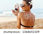 woman applying sun cream  on... | Shutterstock . vector #1368652109