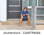 teenage boy typing text message.... | Shutterstock . vector #1368798686