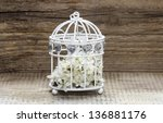 Birdcage With Flowers Inside On ...