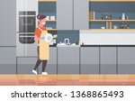young woman washing dishes... | Shutterstock .eps vector #1368865493