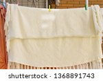 clothes hanging in the clothes... | Shutterstock . vector #1368891743