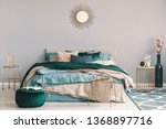 Stock photo blue beige and emerald green bedding on king size bed in contemporary bedroom interior with golden 1368897716