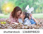 asian mom and her daughter have ... | Shutterstock . vector #1368898820