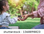 asian mom and her daughter have ... | Shutterstock . vector #1368898823
