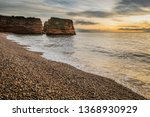 Sunrise Over Ladram Bay On The...