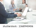 businessman working on laptop... | Shutterstock . vector #1368940406
