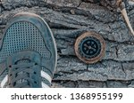Old Compass And Shoes On A...