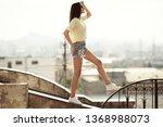 the girl walks on the roof.... | Shutterstock . vector #1368988073
