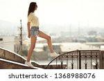 the girl walks on the roof.... | Shutterstock . vector #1368988076