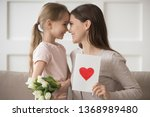 mother and kid looks at eyes... | Shutterstock . vector #1368989480