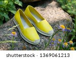 Stock photo yellow espadrilles in nature a pair of espadrilles on stone yellow espadrilles close up summer 1369061213