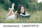 charming young woman reading a... | Shutterstock . vector #1369079573