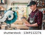 carpenter worker cutting wooden ... | Shutterstock . vector #1369112276