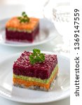 Stock photo herring appetizer with beetroot carrot and avocado 1369147559