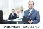 senior businessman with... | Shutterstock . vector #1369161710