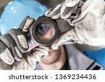 Metallic Hexagon Nut in Worker Hands Closeup Photo. Metalworking Industry. - stock photo