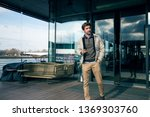 casual businessman walk and use ...   Shutterstock . vector #1369303760