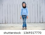 funny child inblue sweater and... | Shutterstock . vector #1369317770