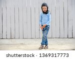 funny child inblue sweater and... | Shutterstock . vector #1369317773