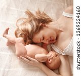 happy mom with newborn daughter ... | Shutterstock . vector #1369324160
