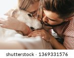 dark haired man and blond woman ... | Shutterstock . vector #1369331576