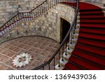 Staircase Covered With Red...