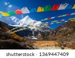 colorful tibetan flags and snow ... | Shutterstock . vector #1369447409