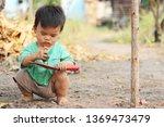 children are holding the soil... | Shutterstock . vector #1369473479