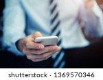 closeup of hand of businessman... | Shutterstock . vector #1369570346