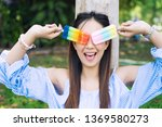 happy young woman with colorful ... | Shutterstock . vector #1369580273